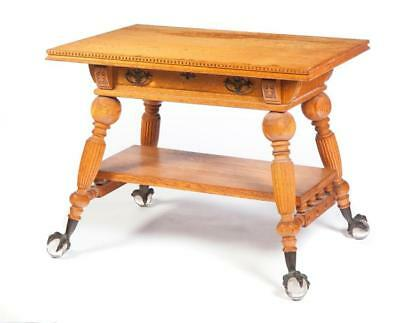 OAK BALL AND CLAW LIBRARY TABLE. Lot 329