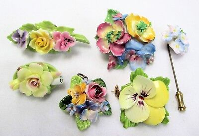 Four vintage ceramic flower design brooches + stick pin + pendant