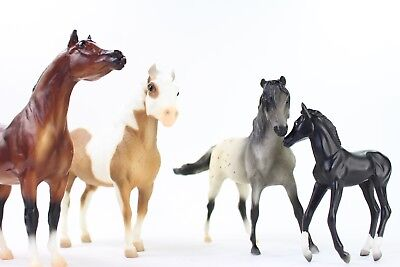 Lot of 4 Breyer Reeves MINIATURE HORSES Toys Collectibles EQUESTRIAN Multi Color
