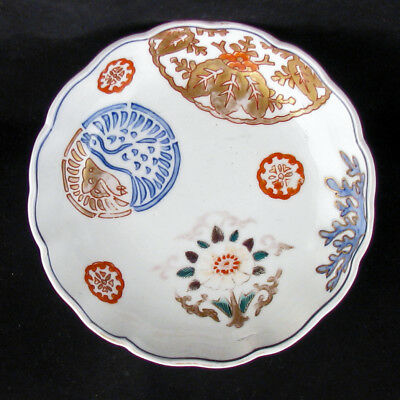 19th Century Shallow Porcelain Japanese Imari Bowl with Buddhist Symbols