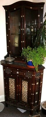 Antique Indian or Middle Eastern solid wood inlaid corner cupboard.