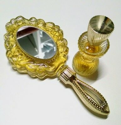 Avon cologne full collectible bottles Unforgettable mirror