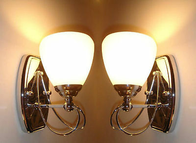 Two elegant sweeping indoor wall lights, chrome plated finish