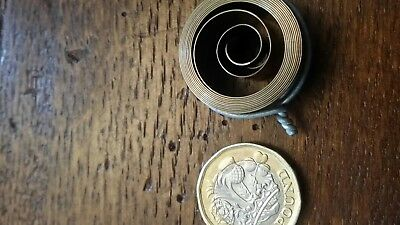 400 day 1406c mainspring  new old stock