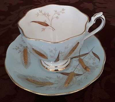 Queen Anne Tea Cup and Saucer Soft Pale Blue Gold Embossed Wheat