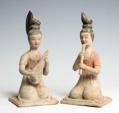 Pair of Chinese Tang dynasty pottery seated female musicians 7th century AD.