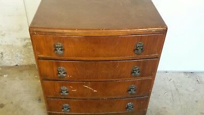 Art deco chest of drawers with ornate handles