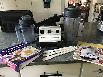Vitamix 5000, 32 oz and 64 oz containers, recipe book, tamper and scrapers