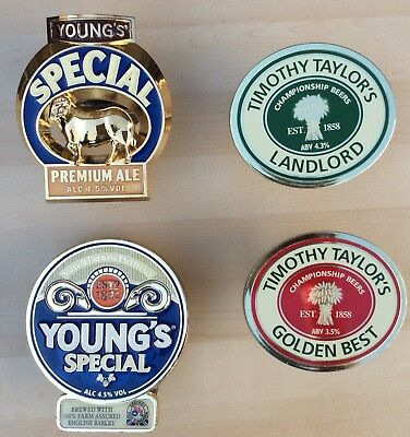 A collection of 4 Plastic Brewery Beer Pump Badges & Clips