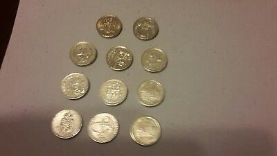 Collectable Eleven old round pound coins includes Belfast City & Legs of man