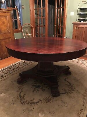 Antique clawfoot mahogany dining table with 7 leaves.