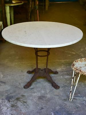 Round marble-top table with cast iron base