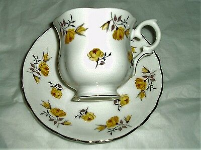 Crown Staffordshire china teacup and saucer , pattern 8910 , yellow floral