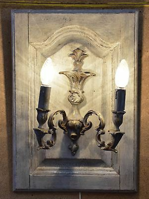 Pair of vintage French wall sconces mounted on salvaged doors