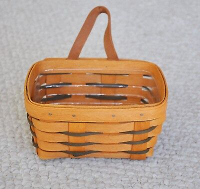 Longaberger basket with hunter green accents, includes coordinating protector