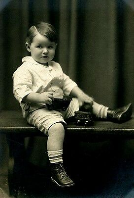 Vintage Portrait of Young Boy with Train Set