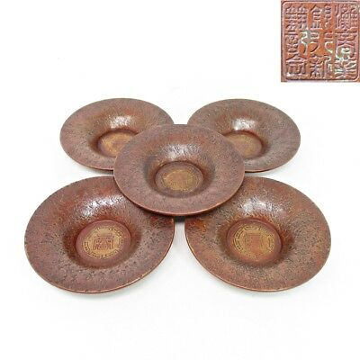 D952: Japanese teacup saucers of high quality copper ware with signature