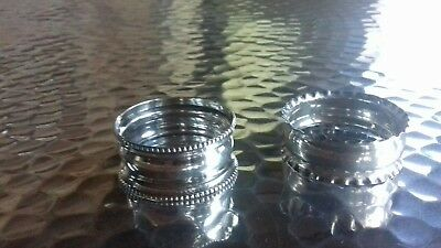 Two Antique Hallmarked Solid Silver Napkin rings .
