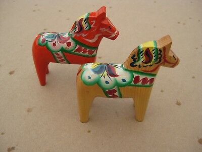 """Two Nils Olsson Swedish Dala Horse 4"""" one Red one Natural Wood Painted"""