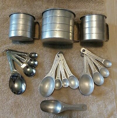 Vintage aluminum, stainless, measuring cups and spoons. Kitchen items.