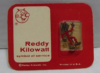 Vintage Reddy Kilowatt Pin sealed in package