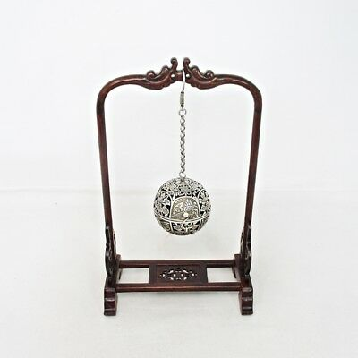 E084: Chinese hanging sphere incense burner of brass like silver w/wooden frame