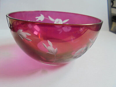 Hand cut red coloured glass bowl with flower pattern.