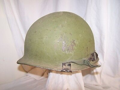 US M1 helmet shell with remains of WW2 cork grit. Reissued c. 1960's-1970's.