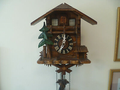 Vintage cuckoo clock with music box