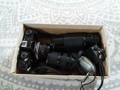 Canon FTB-QL 35mm SLR Film Camera with some Canon FD Lenses and 2 Light Meters