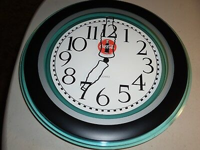 Coca Cola 1996 Coke wall clock With bottle hands