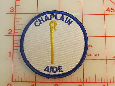 Vintage 70's blue border CHAPLAIN AIDE unused badge of office patch (oB)