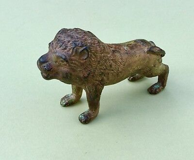 Small antique metal lion measures approx 14cm long x 8cm high No Makers mark ,