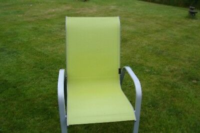 Chair in lime green with silver frame can be used outdoors