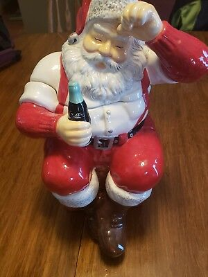 Coca cola ceramie earthenware Santa cookie jar sitting on box. 13 inches 2002