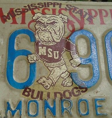 Mississippi State License Plate w vintage MSU BULLDOGS LOGO Sticker on it MG6906