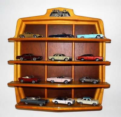 Franklin Mint Classic Cars of the sixties - 12 Modelle inkl. Regal Dokumentation
