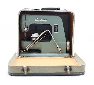 Darling Vintage Sewing machine in case with manual