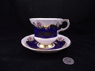 Paragon  Cobalt Blue With Gold And Flowers Cabinet Tea Cup And Saucer