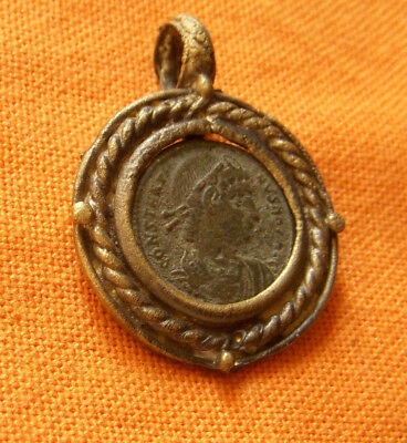 A70. Roman style bronze pendant with authentic Roman coin
