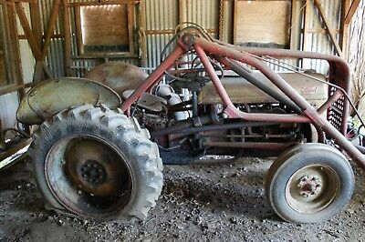 Vintage 1951 Ford 8N farm tractor with snow plow blade and front loader.