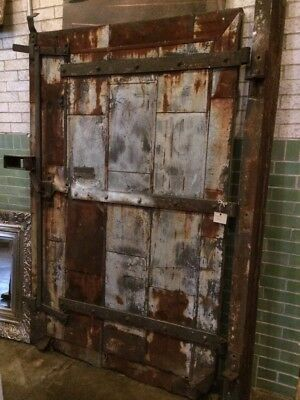 Old, Industrial Metal Fire Door. Weathered with unique great patina.