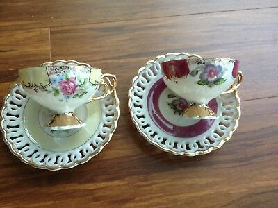 Lovely Asian (Japan) set 2 caps and 2 sauser , Fine China ( made in Japan).