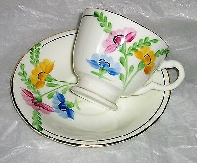 Delphine tea cup and saucer , English china with gold trim floral