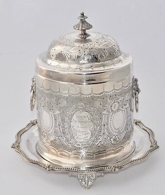 Outstanding 1876 Silver Plate Biscuit Barrel on Attached Plate - Hand Chased