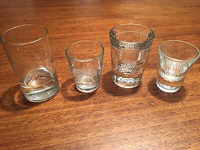Lot of 4 shot glasses.  Includes 1 Johnnie Walker and 1 Harley Davidson glass.