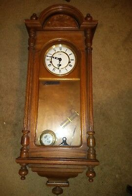 Howard Miller 612-462 Oak Wall 8 Day Clock with Westminster Chime Key Wind