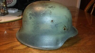 M42 german helmet with liner No chinstrap, with a Normandy camo.