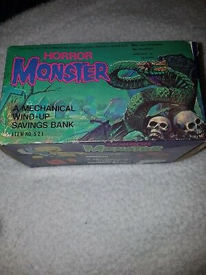 HORROR MONSTER MECHANICAL WIND-UP SAVING BANK MONEY BOX FROM EARLY 70s NEW BOXED