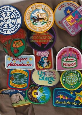 2 VEST WITH LOTS OF GIRL SCOUT PATCHES. 1990,s.